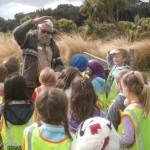 Mark-Oster,-Environment Southland -Education-Officer,-tells-Gorge-Road-School-juniors-about-what-lives-in-wetlands.
